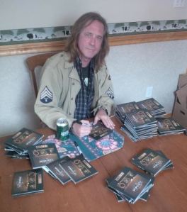 Russ Dwarf - 2013 - Autographing CD's - promo pic